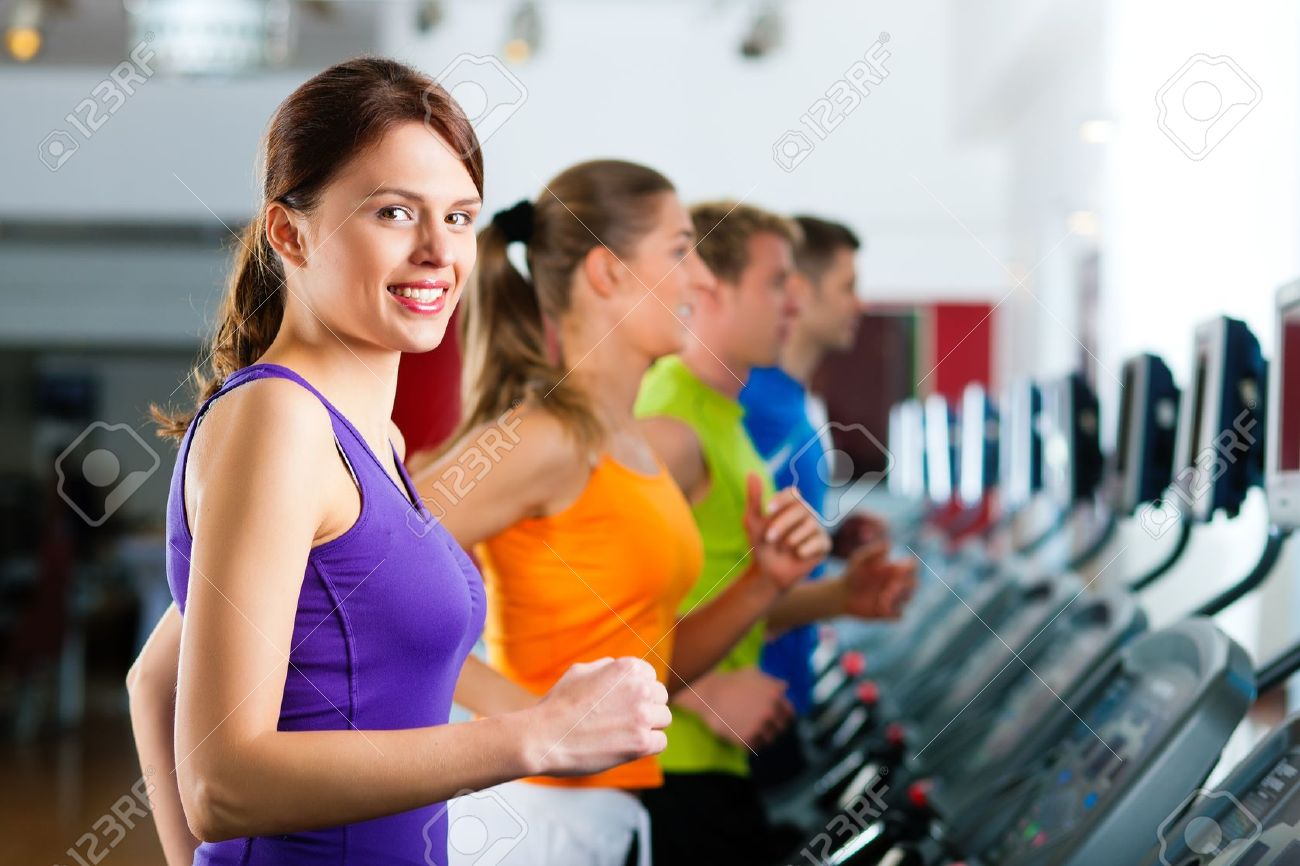 10448777-Running-on-treadmill-in-gym-or-fitness-club-group-of-women-and-men-exercising-to-gain-more-fitness-Stock-Photo