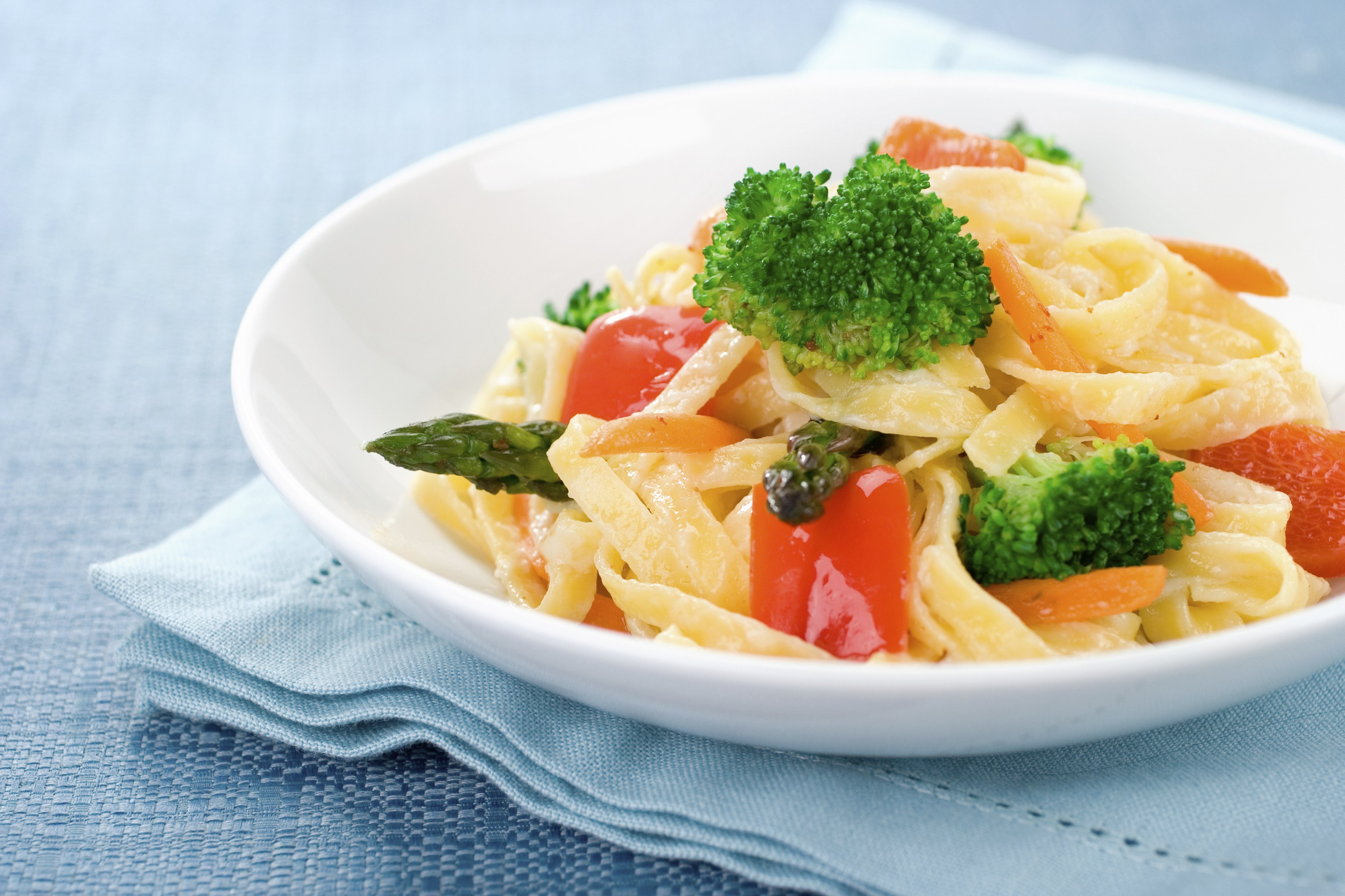 Delicious fresh vegetables tossed with fresh ribbon pasta make up this healthy and delectable Pasta Primavera.  Shallow dof
